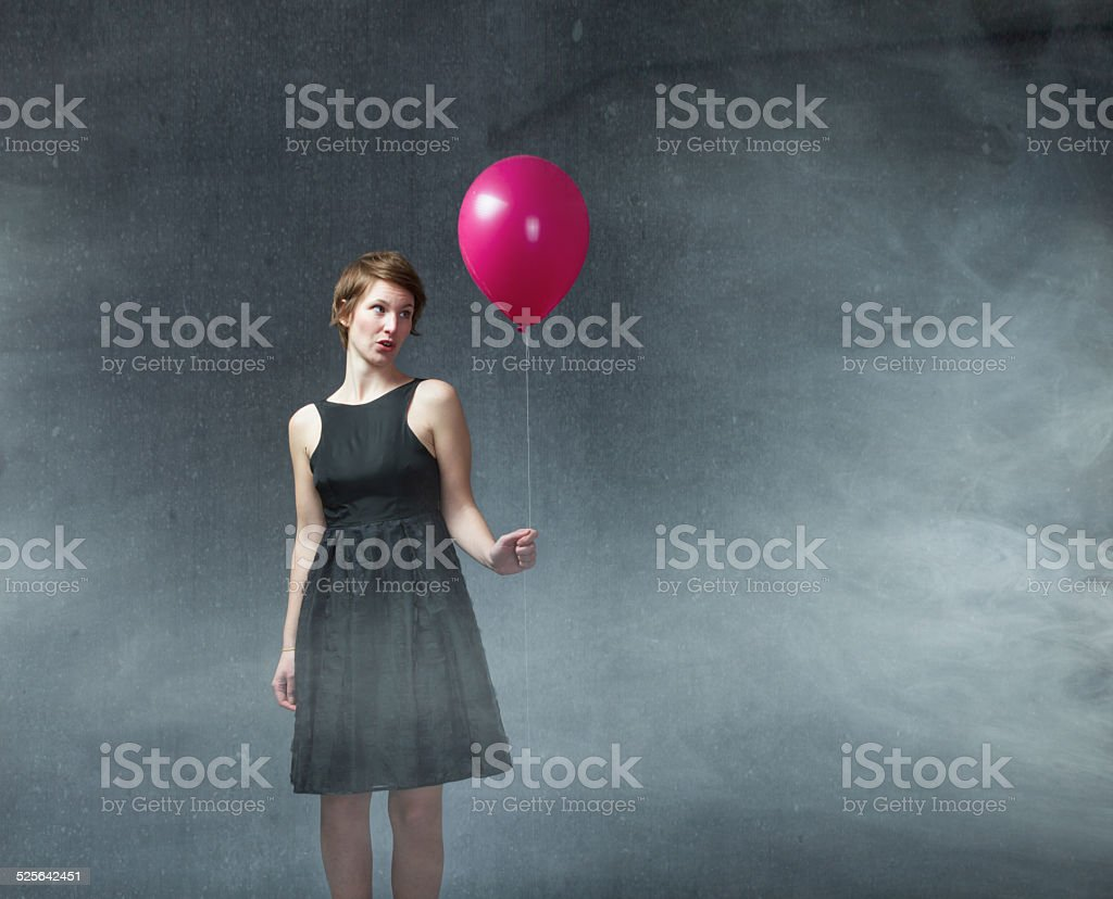 Woman With Dress Party And Helium Balloon On Hand stock photo | iStock
