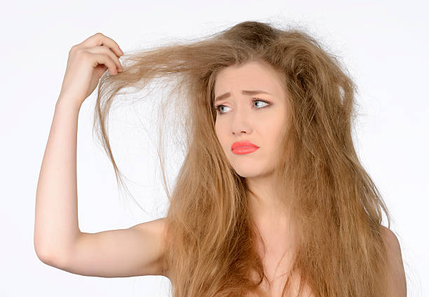 woman with dry hair - kabarık saç stok fotoğraflar ve resimler