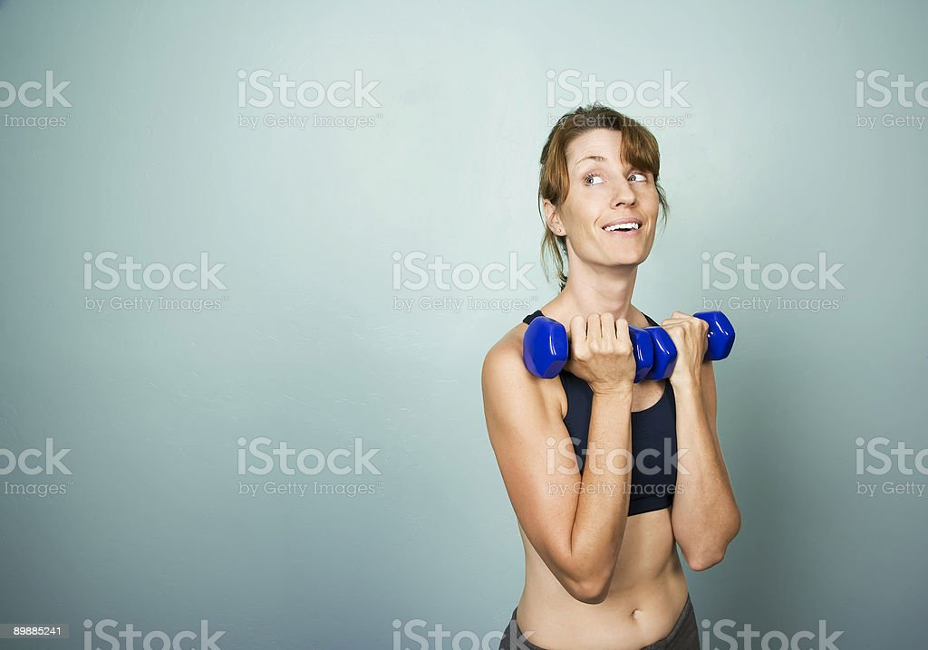Woman with Dumbbells royalty free stockfoto