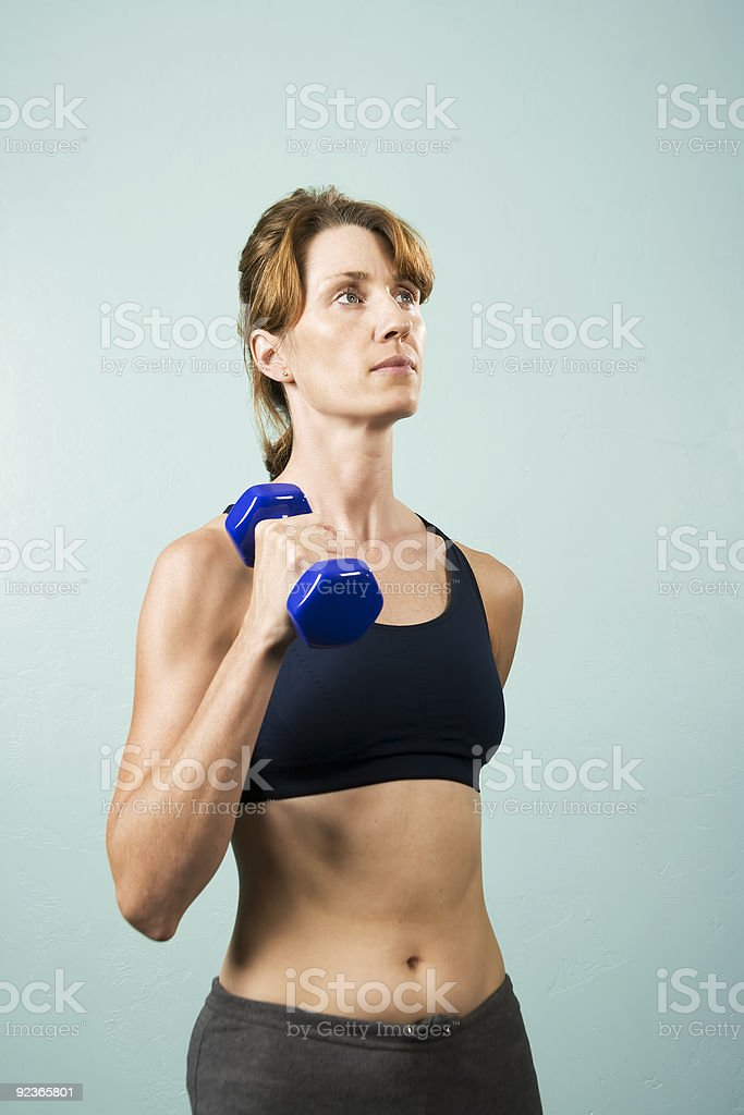 Woman with Dumbbells royalty-free stock photo