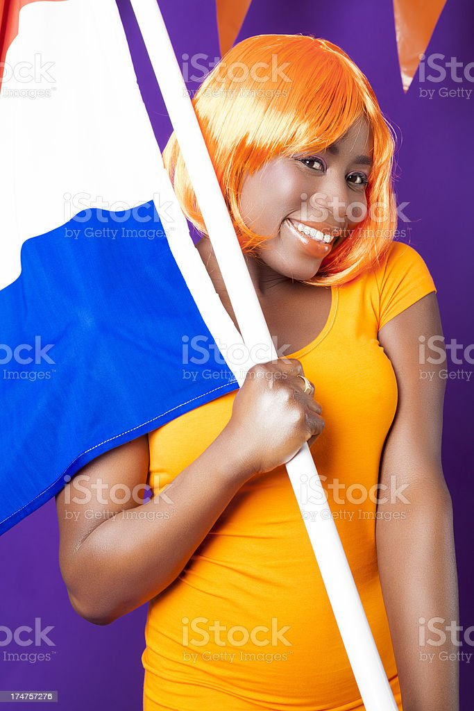 Woman with Dutch flag celebrating stock photo