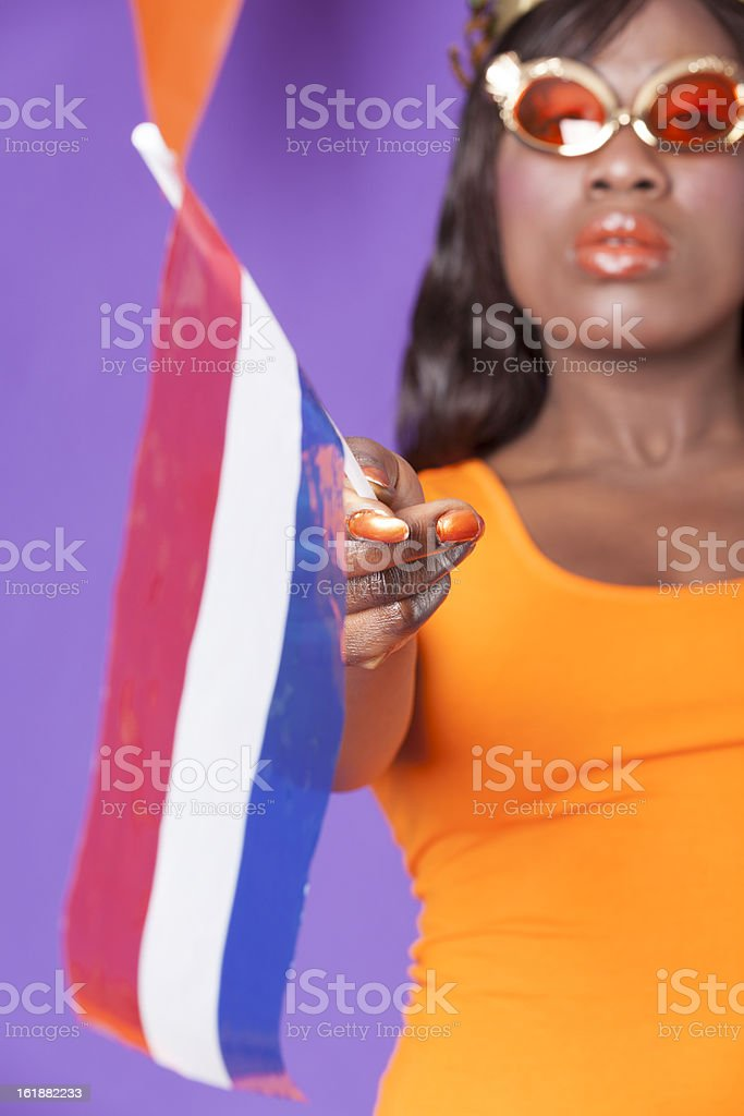Woman with Dutch flags celebrating stock photo