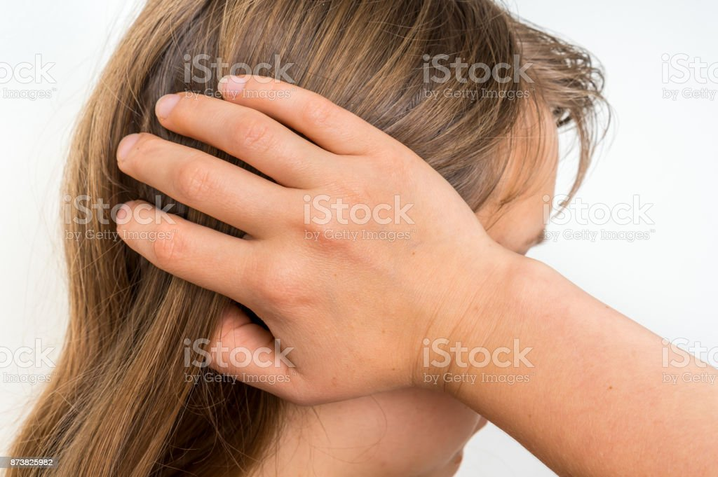Woman with earache is holding her aching ear stock photo