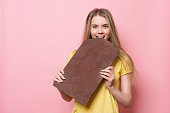 Woman with eats chocolate smiling
