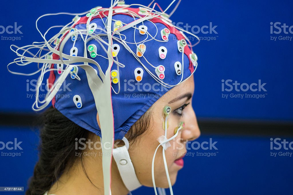 Woman with EEG and EOG electrodes in laboratory stock photo