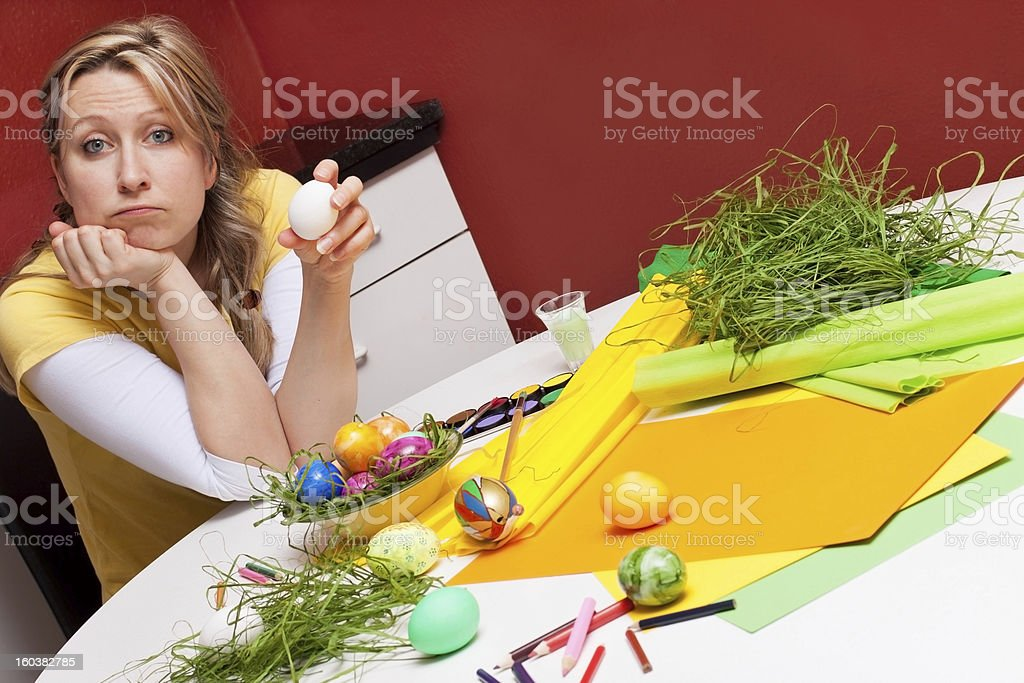 Woman with egg looks questioningly at viewer royalty-free stock photo