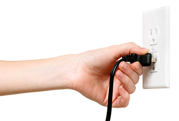 Woman with Electrical Outlet Plug on White stock photo