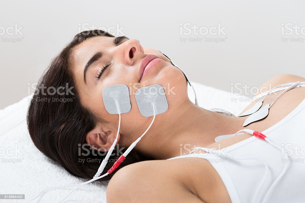 Woman With Electrodes On Her Face stock photo