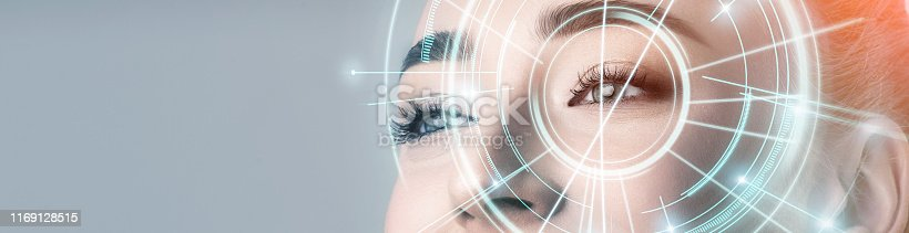 istock Woman with electronic information analysing inside eye 1169128515