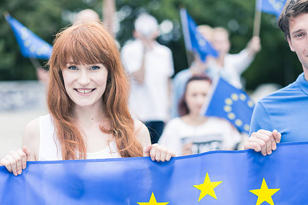 woman with european union flag - citizenship stock photos and pictures