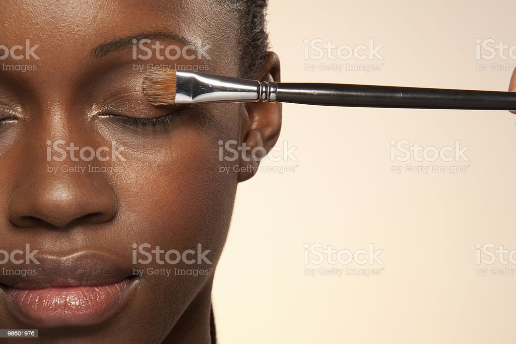 Woman with eye make up brush on eye royalty-free 스톡 사진