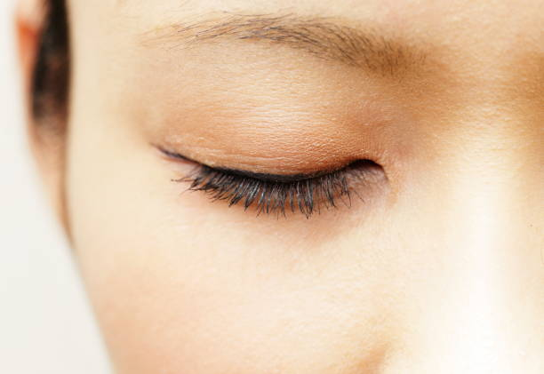 woman with eyelid closed - eyelid stock pictures, royalty-free photos & images