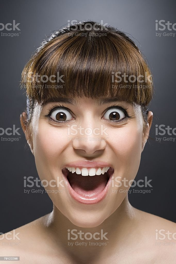 Woman with eyes wide stock photo
