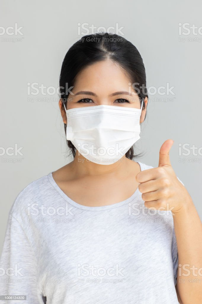 woman with face mask stock photo