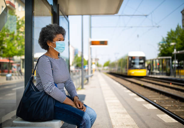Woman with face mask travelling in berlin tram during Covid-19 outbreak stock photo