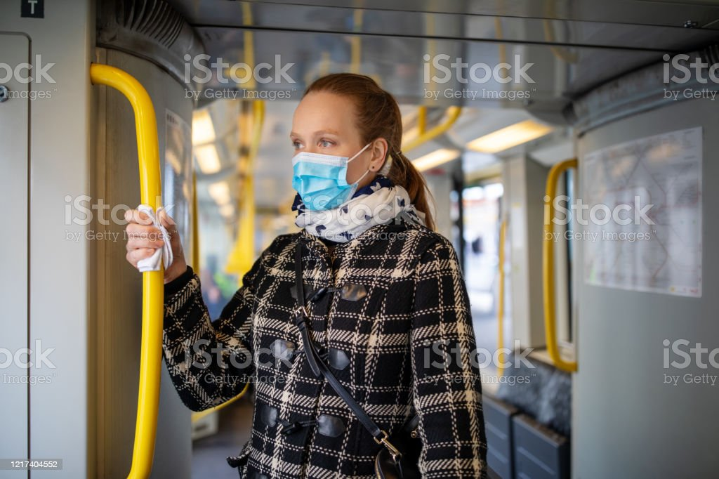 Woman with face mask travelling in metro during Covid-19 outbreak - Royalty-free Accidents and Disasters Stock Photo