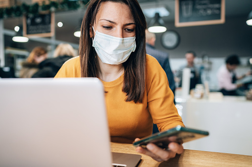 istock Woman with face protective mask 1208457324