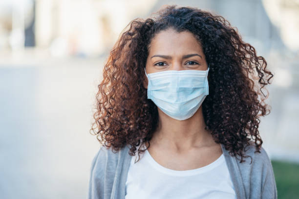 Woman with face protective mask stock photo