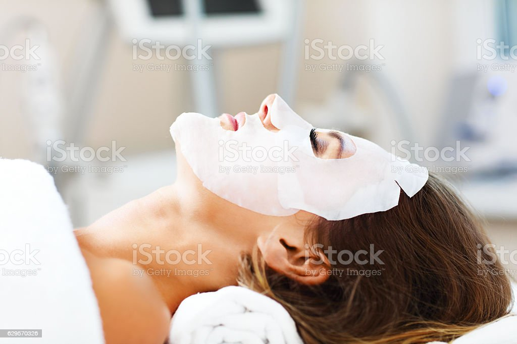 Woman with facial mask in beauty salon royalty-free stock photo