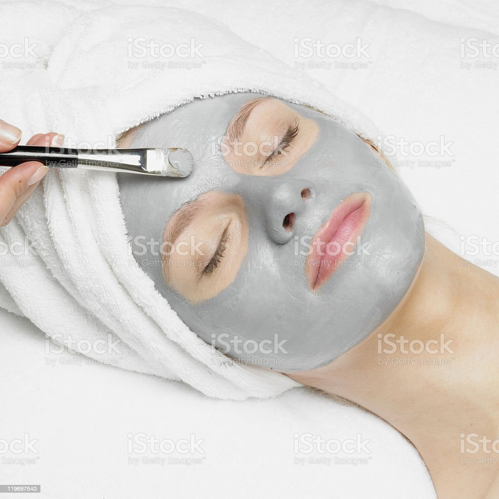 woman with facial mask royalty-free stock photo