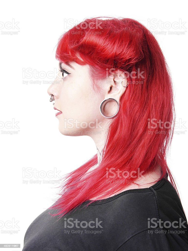woman with facial piercings stock photo