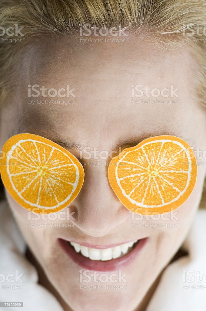 Woman with fake orange slices on eyes royalty-free 스톡 사진