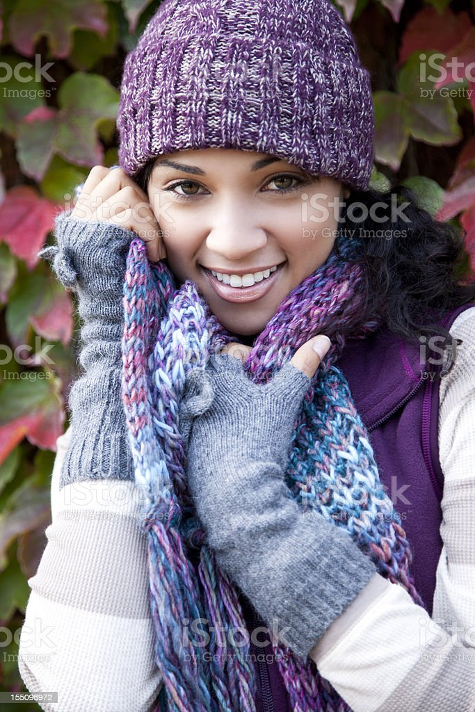 Woman with fall outfit smiling royalty-free stock photo