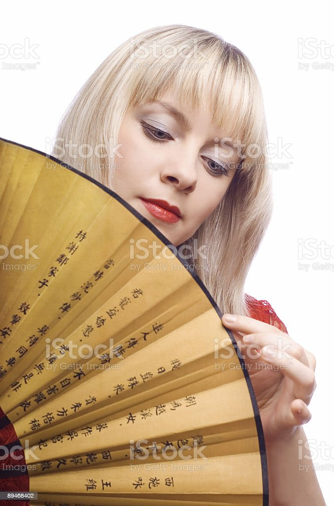 woman with fan royalty-free stock photo