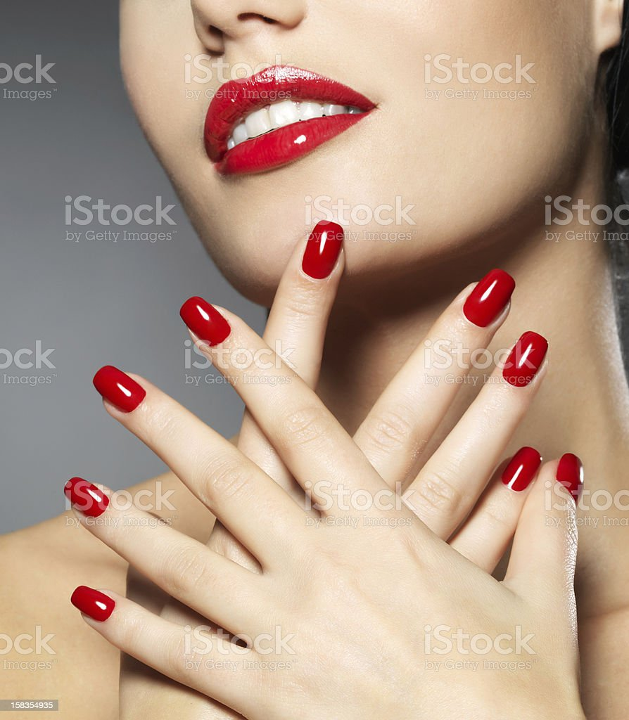 woman with fashion red nails and sensual lips royalty-free stock photo