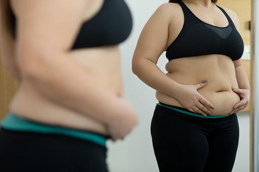 Woman with fat abdomen