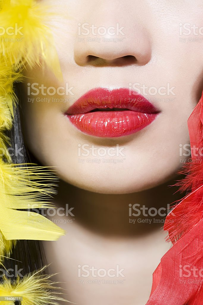 Woman with feathers around her face foto de stock royalty-free