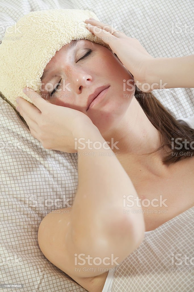 woman with fever in bed royalty-free stock photo