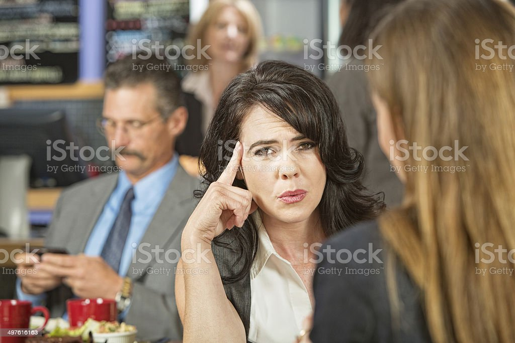 Woman with Finger on Head stock photo