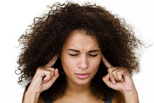 woman with fingers in ears - covering ears stock photos and pictures