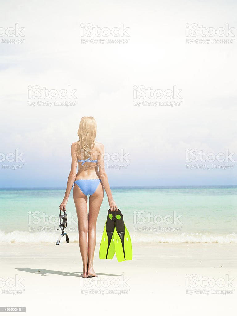 Woman with fins and mask stock photo