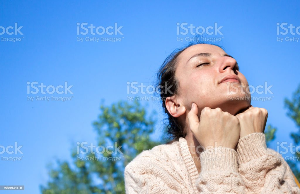 Woman with fists on chin. stock photo