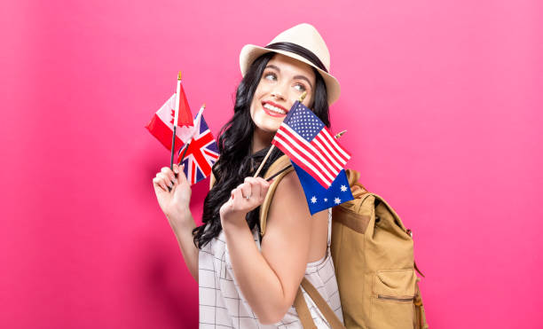 woman with flags of english speaking countries - inghilterra foto e immagini stock