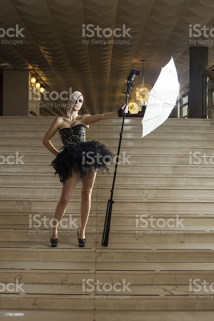 Woman with flash on stairs royalty-free stock photo