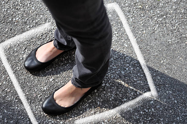 woman with flat shoes and white line on the floor - flat shoe stock photos and pictures
