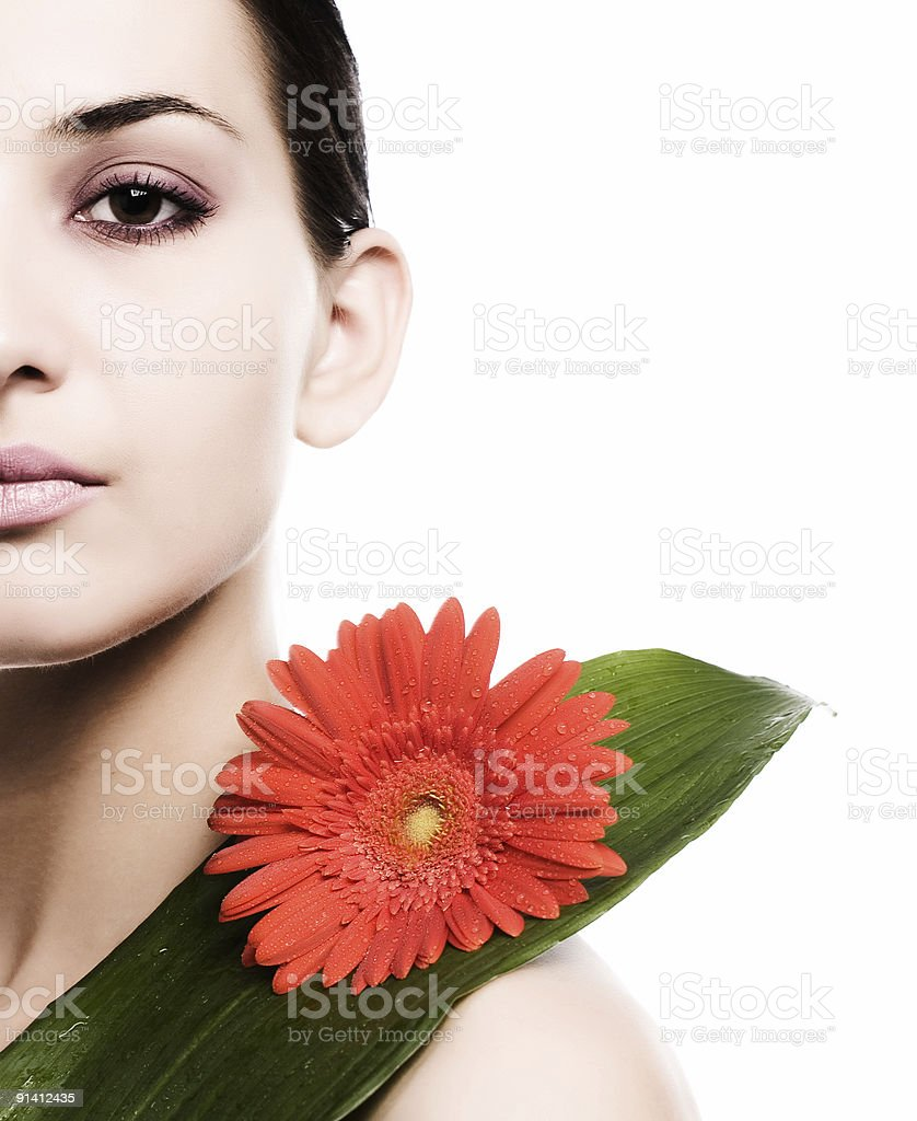 Woman with flower and leaf royalty-free stock photo