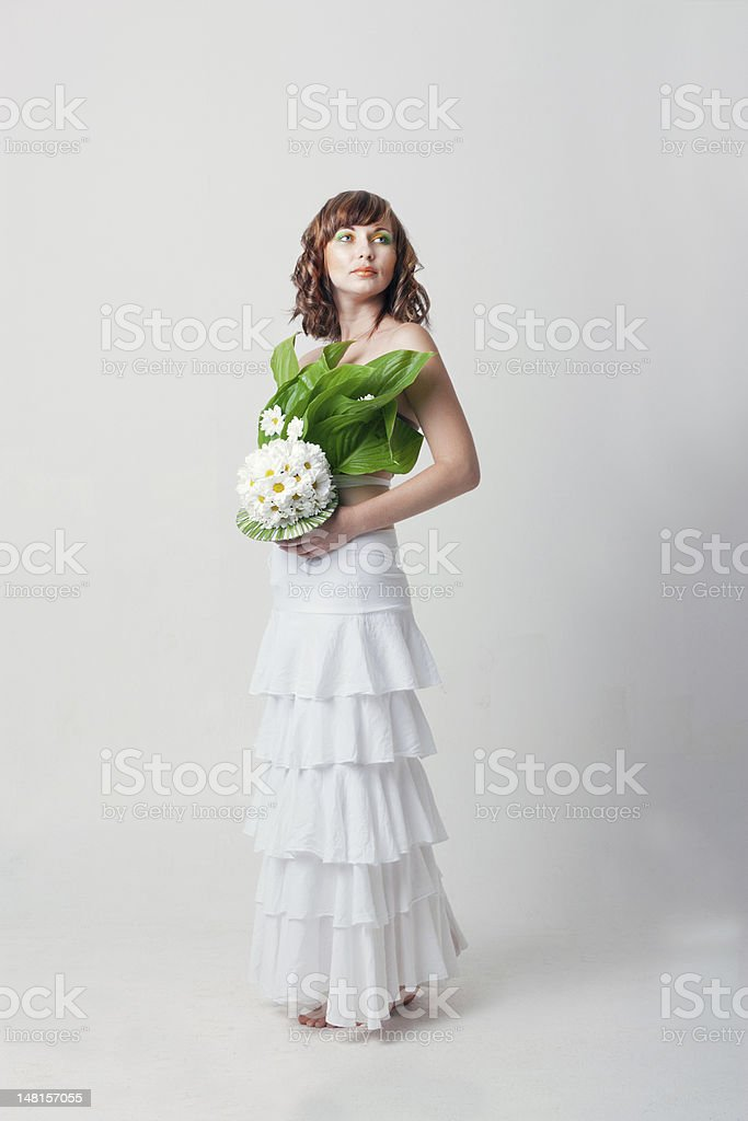 woman with flower look sideways royalty-free stock photo