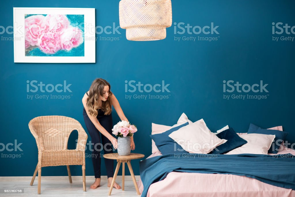 Woman with flowers at home stock photo