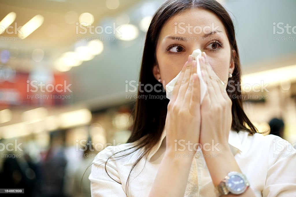 Woman With Flu At Public Place stock photo