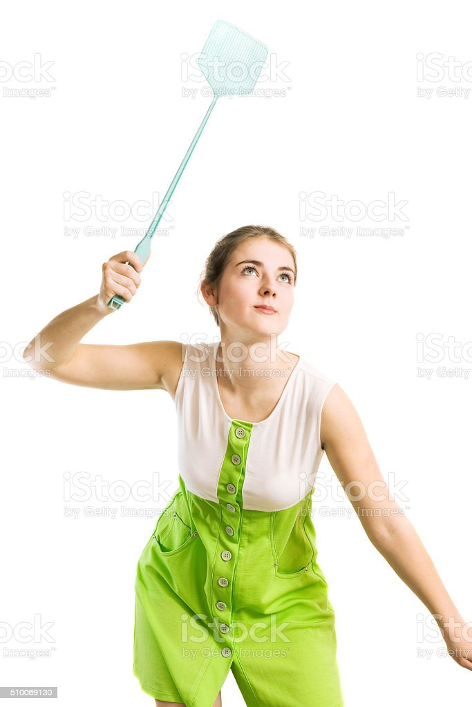 woman with fly swatter stock photo