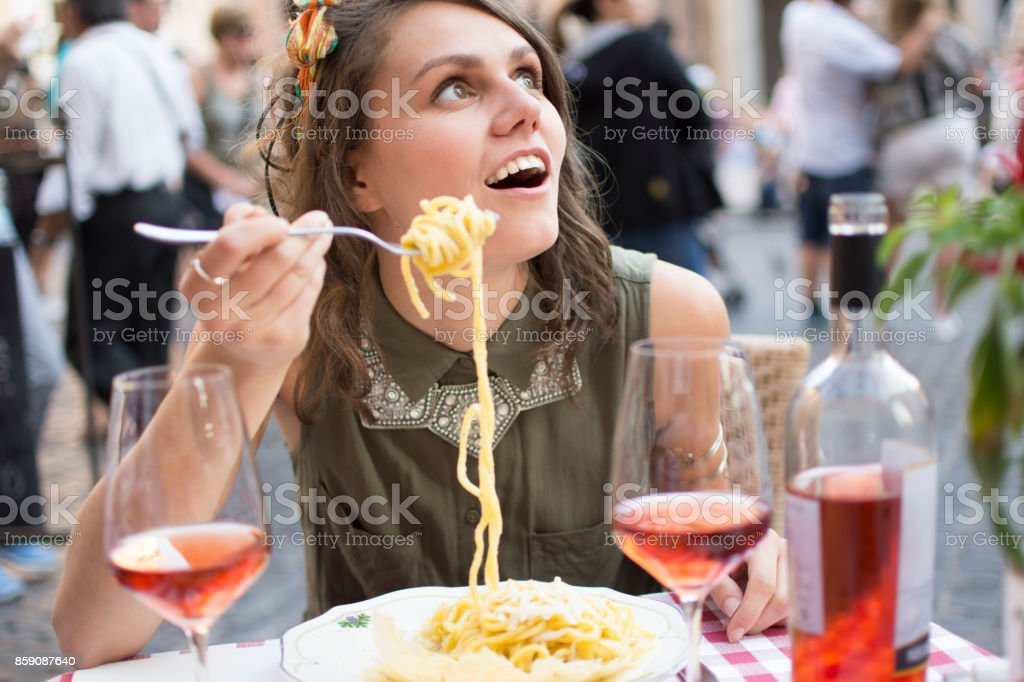 Woman With Forkful of Spaghetti stock photo