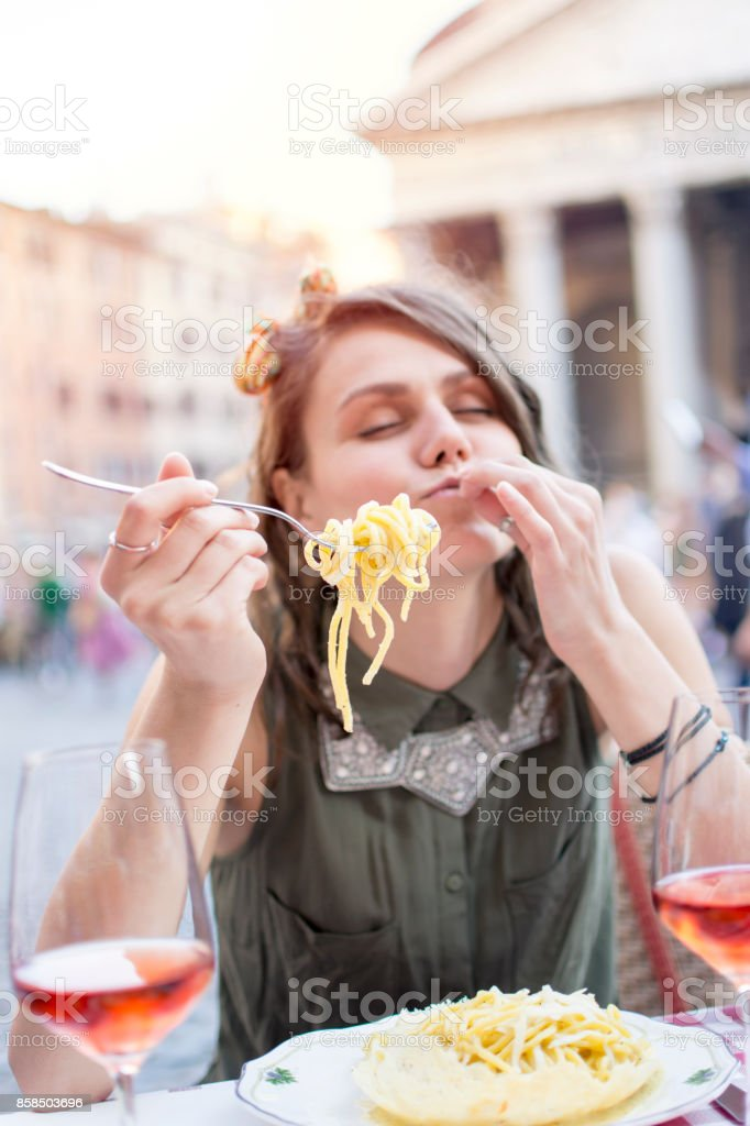 Woman With Forkful of Spaghetti, Rome, Italy stock photo
