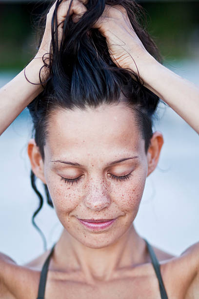 Woman with freckles Portrait of a woman with freckles wet hair stock pictures, royalty-free photos & images