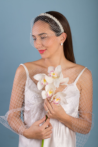 Woman with fresh orchid branch