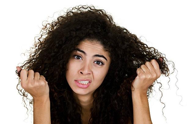 woman with frizzy hair - kabarık saç stok fotoğraflar ve resimler