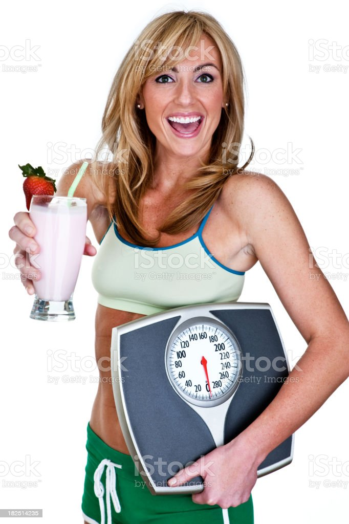 Woman with fruit smoothie and weight scale royalty-free stock photo